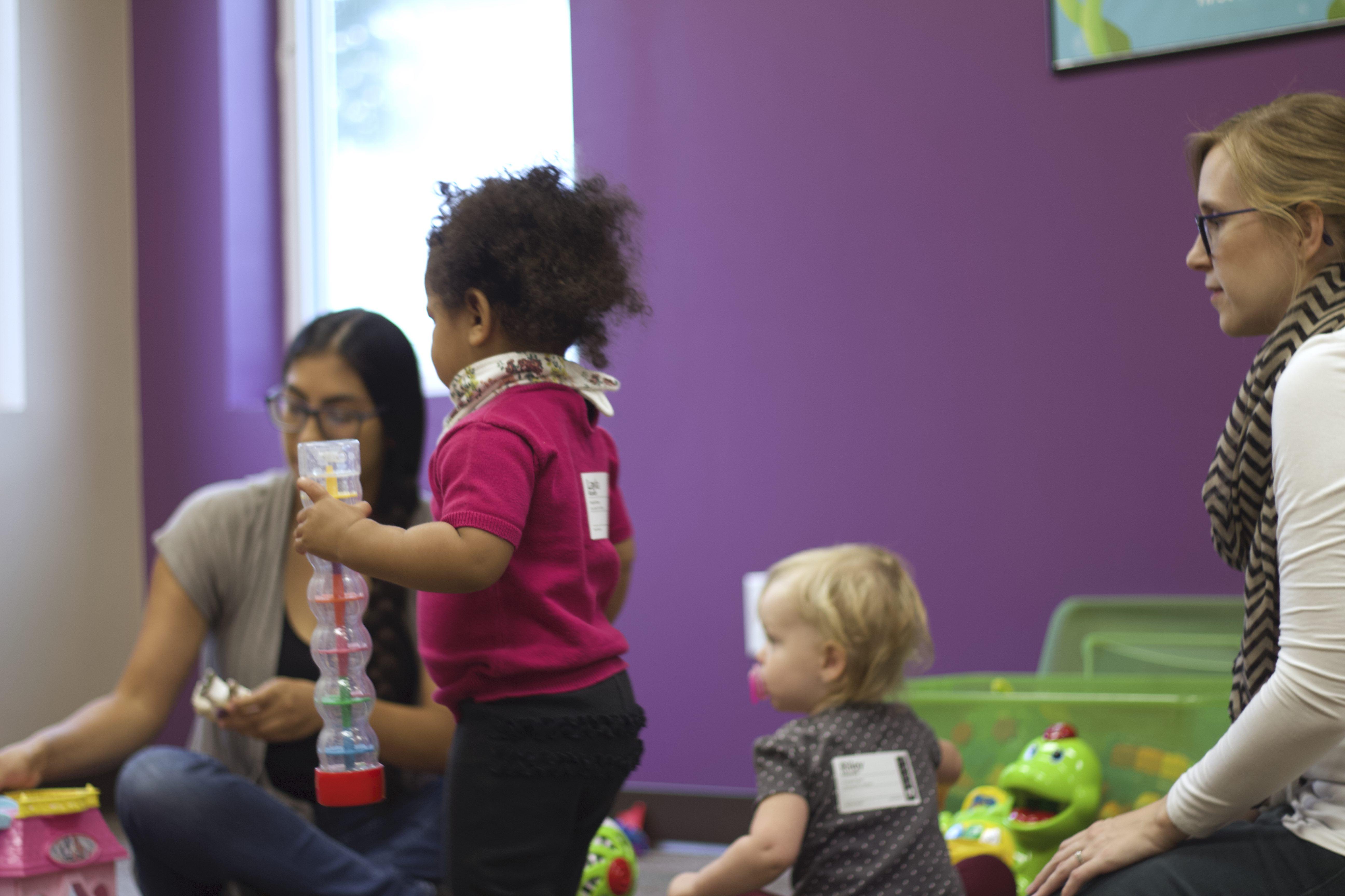 Kids with teachers in the nursery
